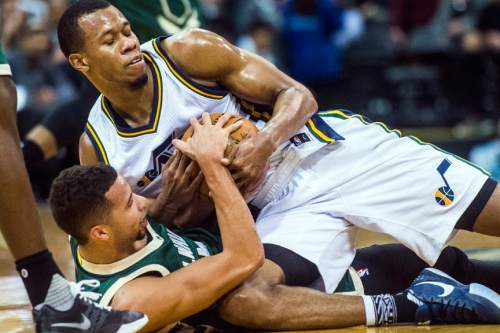 Chris Detrick  |  The Salt Lake Tribune Utah Jazz guard Rodney Hood (5) and Milwaukee Bucks guard Michael Carter-Williams (5) fight for the ball during the game at Vivint Smart Home Arena Friday February 5, 2016.