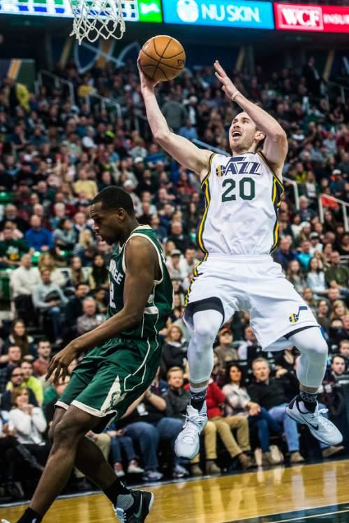 Chris Detrick  |  The Salt Lake Tribune Utah Jazz forward Gordon Hayward (20) shoots past Milwaukee Bucks guard Khris Middleton (22) during the game at Vivint Smart Home Arena Friday February 5, 2016.