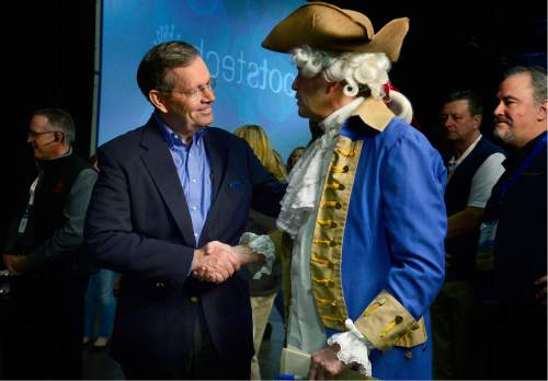 Scott Sommerdorf   |  The Salt Lake Tribune Former Utah Governor Mike Leavitt speaks with Scott Fisher, the host of a radio show who was dressed to promote a cruise from Boston, at the RootsTech conference at the Salt Palace, Saturday, February 6, 2016.