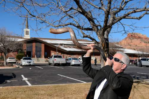 "Trent Nelson  |  The Salt Lake Tribune Brand Thornton blows a shofar before the funeral for Robert ""LaVoy"" Finicum, in Kanab, Friday February 5, 2016. Finicum was shot and killed by police during a January 26 traffic stop. Finicum was part of the armed occupation of an Oregon wildlife refuge."