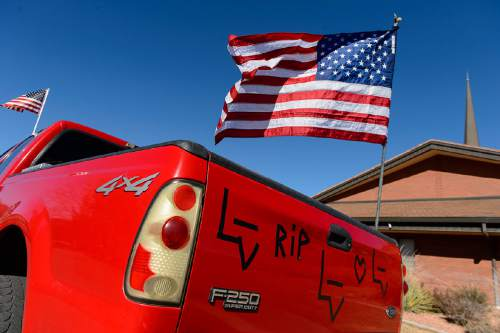 "Trent Nelson  |  The Salt Lake Tribune Flags and tape on a 4x4 truck at the funeral for Robert ""LaVoy"" Finicum, in Kanab, Friday February 5, 2016. Finicum was shot and killed by police during a January 26 traffic stop. Finicum was part of the armed occupation of an Oregon wildlife refuge."
