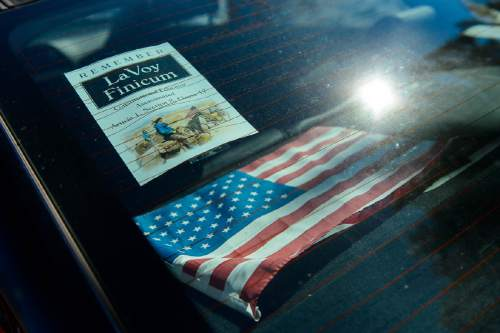 "Trent Nelson  |  The Salt Lake Tribune A flyer in the rear window of a car at the funeral for Robert ""LaVoy"" Finicum, in Kanab, Friday February 5, 2016. Finicum was shot and killed by police during a January 26 traffic stop. Finicum was part of the armed occupation of an Oregon wildlife refuge."