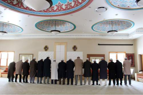 In this Jan. 25, 2016, photo, muslim men come together for afternoon prayers at Golden Generation Worship & Retreat Center, in Saylorsburg, Pa. Muslim scholar Fethullah Gulen, who lives on the grounds of Golden Generation, has long been one of Turkey's most important scholars, with multitudes of followers in his native country and around the world. More recently, he has become the chief antagonist of Turkey's increasingly autocratic president, Recip Erdogan, who accuses Gulen of plotting to overthrow the government from his Pennsylvania idyll some 5,000 miles away. (AP Photo/Michael Rubinkam)