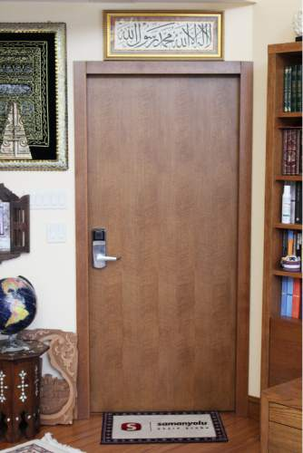 This Jan. 25, 2016 photo shows the door leading to Fethullah Gulen's living quarters at the Golden Generation Worship & Retreat Center, in Saylorsburg, Pa. Rarely seen in public, Gulen has long been one of Turkey's most important scholars, with multitudes of followers in his native country and around the world. More recently, he has become the chief antagonist of Turkey's increasingly autocratic president, Recip Erdogan, who accuses Gulen of plotting to overthrow the government from his Pennsylvania idyll some 5,000 miles away. (AP Photo/Michael Rubinkam)