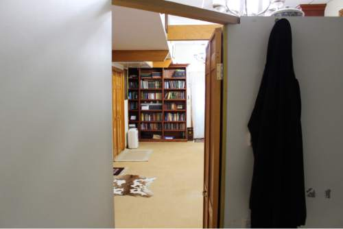 In this Jan. 25, 2016, photo, Fethullah Gulen's work space is seen through the doorway to his bedroom at the Golden Generation Worship & Retreat Center, in Saylorsburg, Pa. Rarely seen in public, Gulen has long been one of Turkey's most important scholars, with multitudes of followers in his native country and around the world. More recently, he has become the chief antagonist of Turkey's increasingly autocratic president, Recip Erdogan, who accuses Gulen of plotting to overthrow the government from his Pennsylvania idyll some 5,000 miles away. (AP Photo/Michael Rubinkam)