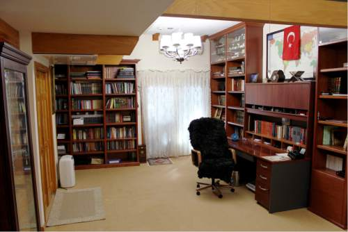 This Jan. 25, 2016 photo shows Fethullah Gulen's work space at the Golden Generation Worship & Retreat Center, in Saylorsburg, Pa. Rarely seen in public, Gulen has long been one of Turkey's most important scholars, with multitudes of followers in his native country and around the world. More recently, he has become the chief antagonist of Turkey's increasingly autocratic president, Recip Erdogan, who accuses Gulen of plotting to overthrow the government from his Pennsylvania idyll some 5,000 miles away. (AP Photo/Michael Rubinkam)