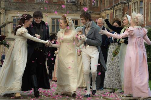 """This photo provided by Sony/Screen Gems shows, Lily James, from left, Sam Riley, Bella Heathcote, Douglas Booth, Charles Dance and Suki Waterhouse in Screen Gems' """"Pride and Prejudice and Zombies.""""  (Jay Maidment/Sony/Screen Gems via AP)"""