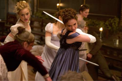 """This image released by Screen Gems shows Lily James in a scene from """"Pride and Prejudice and Zombies."""" (Jay Maidment/Screen Gems, Sony via AP)"""
