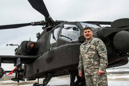 Chris Detrick  |  The Salt Lake Tribune Lt. Col. Matthew Badell poses for a portrait next to a AH-64 Apache helicopter at the Utah National Guard aviation armory in West Jordan Thursday February 4, 2016.