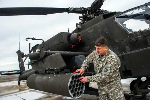 Chris Detrick  |  The Salt Lake Tribune Lt. Col. Matthew Badell looks over a AH-64 Apache helicopter at the Utah National Guard aviation armory in West Jordan Thursday February 4, 2016.