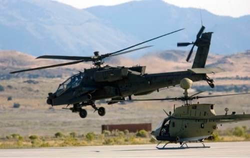Al Hartmann  |  The Salt Lake Tribune Aircraft of the Unmanned System Integration Capability (MUSIC) was demonstrated at Dugway Proving Grounds Thursday September 15.  An Apache helicopter, left, takes off followed by a Kiowa during demonstration excercise.