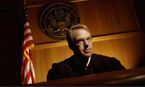 United States District Court Judge Paul Cassell has surprised critics who said he would take the bench with a conservative agenda. He's told lawyers to ask for lighter sentences when called for and is questioning the constitutionality of mandatory minimum sentences.   Photo by Francisco Kjolseth/The Salt Lake Tribune 02/26/2004