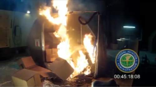 FILE - This file frame grab from video, provided by the Federal Aviation Administration (FAA) shows a test at the FAAs technical center in Atlantic City, N.J. last April, where a cargo container was packed with 5,000 rechargeable lithium-ion batteries. Accident investigators are recommending the government require air shipments of rechargeable batteries be separated from other flammable cargo to prevent uncontrollable fires that can destroy planes. The National Transportation Safety Board said its recommendation is based on an investigation by South Korean authorities of the destruction of an Asiana Airlines cargo plane in July 2011. (AP Photo/FAA, File)