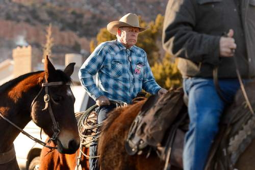 "Trent Nelson  |  The Salt Lake Tribune Cliven Bundy rides in a procession at the funeral for Robert ""LaVoy"" Finicum, in Kanab, Friday February 5, 2016. Finicum was shot and killed by police during a January 26 traffic stop. Finicum was part of the armed occupation of an Oregon wildlife refuge."