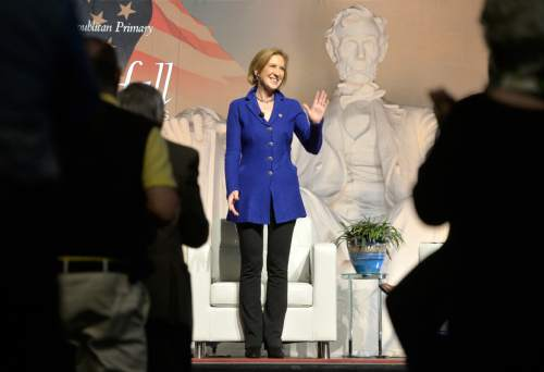 Republican presidential candidate Carly Fiorina acknowledges applause from the crowd after she is introduced at a town hall meeting at the University of South Carolina at Aiken Convocation Center, Friday afternoon, Oct. 2, 2015, in Aiken, S.C.  (Michael Holahan/The Aiken Standard via AP) MANDATORY CREDIT
