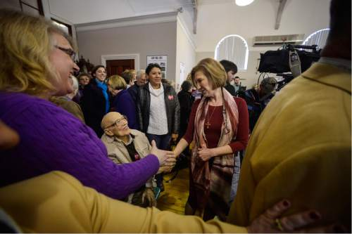 Republican presidential candidate Carly Fiorina shakes hands with people as she enters the Historical Society of Cheshire County in Keene, N.H., Sunday, Feb. 7, 2016. (Kristopher Radder/The Brattleboro Reformer via AP) MANDATORY CREDIT