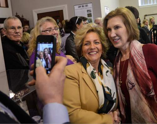 Republican presidential candidate Carly Fiorina takes a moment to take a photo with a supporter during a visit to the Historical Society of Cheshire County in Keene, N.H., Sunday, Feb. 7, 2016. (Kristopher Radder/The Brattleboro Reformer via AP) MANDATORY CREDIT