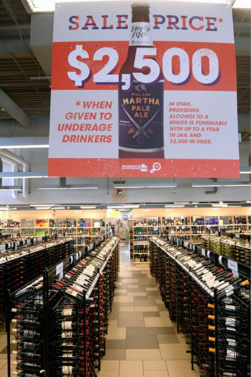 Al Hartmann |  Tribune file photo Posters and tags hanging from liquor bottles remind patrons of the legal and financial costs of supplying alcohol to those who are underage at the Utah State Liquor Store at 1814 E. Murray Holladay Road.
