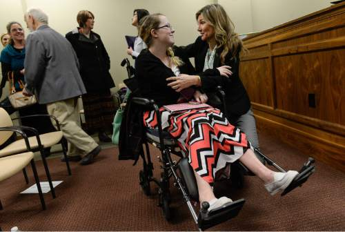 Francisco Kjolseth | The Salt Lake Tribune Jackie Dillard, 28, of Ogden who has had 37 surgeries due to Ehlers Danlos Syndrome and Osteonecrosis, celebrates a small victory with Christine Stenquist who has a brain tumor, after the medical marijuana bill, SB73, passed out of committee on Thursday night.