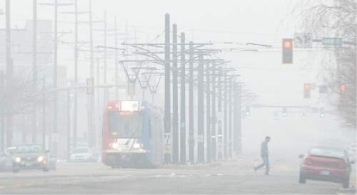 "Francisco Kjolseth | The Salt Lake Tribune Pool air quality blankets the valley, obscuring visibility and increasing health concerns. A sizable source of emissions, comes from ""warming up"" your car, a widespread practice in Utah.Last month Salt Lake City police found 600 unattended, idling vehicles in the space of three hours, even though itís completely unnecessary. For modern cars, all idling does is release a lot of emissions."