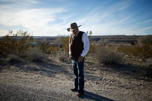 FILE - In this Jan. 27, 2016, file photo, rancher Cliven Bundy stands along the road near his ranch in Bunkerville, Nev. Bundy, the father of the jailed leader of the Oregon refuge occupation, and who was the center of a standoff with federal officials in Nevada in 2014, was arrested in Portland on Wednesday night, Feb. 10, the FBI said, Thursday, Feb. 11, 2016. (AP Photo/John Locher, File)