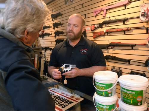 Al Hartmann     Tribune file photo A bill in the Utah Legislature would give legal immunity to gun dealers or manufactuerers. In this file photo, Stuart Wallin, owner of Get Some Guns and Ammo helps a customer with advice on a handgun at the flagship store in Murray.