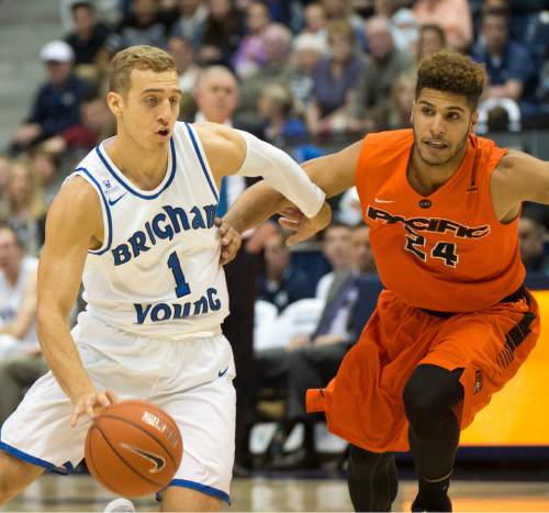 Rick Egan  |  The Salt Lake Tribune  Brigham Young Cougars guard Chase Fischer (1) takes the ball inside as Pacific Tigers forward David Taylor (24) defends,  in WCC basketball action, Brigham Young Cougars vs. The Pacific Tigers, Saturday, February 6, 2016.