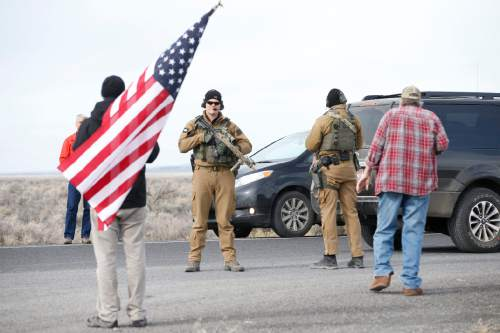 Thomas Boyd  |  The Oregonian/AP Authorities wait at the Narrows roadblock near the Malheur National Wildlife Refuge on Thursday, near Burns, Ore. The last four occupiers of a national wildlife refuge in eastern Oregon surrendered Thursday. The holdouts were the last remnants of a larger group that seized the wildlife refuge nearly six weeks ago, demanding that the government turn over the land to locals and release two ranchers imprisoned for setting fires.