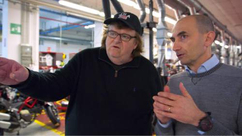 """Michael Moore (left) meets Claudio Domenicali, CEO of the Italian motorcycle maker Ducati, as he looks for ideas to make America better, in his latest op-ed documentary, """"Where to Invade Next."""" Courtesy Eleven Foot Pole"""