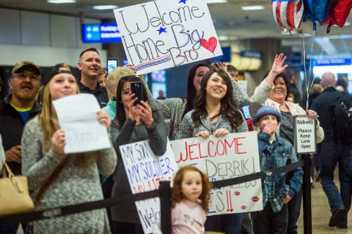 Chris Detrick  |  The Salt Lake Tribune Families wait for their soldiers to arrive at the Salt Lake International Airport Friday February 12, 2016.  Soldiers assigned to the Utah Army National Guard's 19th Special Forces Group returned to Utah on Friday after a six-month deployment in Afghanistan.