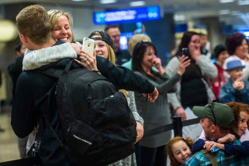 Chris Detrick  |  The Salt Lake Tribune Mindy Black hugs her son Jacob Black as Mack Christensen hugs his daughters Heidi, 5, and Tamsine, 7, at the Salt Lake International Airport Friday February 12, 2016.  Soldiers assigned to the Utah Army National Guard's 19th Special Forces Group returned to Utah on Friday after a six-month deployment in Afghanistan.