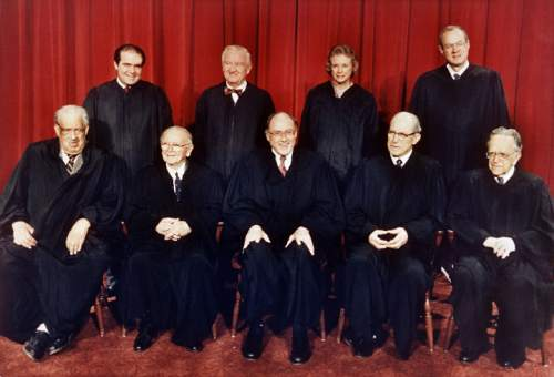 FILE - In this April 15, 1988 file photo, members of the U.S. Supreme Court pose for a formal portrait in Washington. From left, front row are: Associate Justices Thurgood Marshall; William Brennan, Jr.; Chief Justice William Rehnquist; Byron White; and Harry Blackmun. Back row from left are: Antonin Scalia; John Paul Stevens; Sandra Day O'Connor and Anthony M. Kennedy. On Saturday, Feb. 13, 2016, the U.S. Marshals Service confirmed that Scalia has died at the age of 79. (AP Photo/Bob Daugherty)