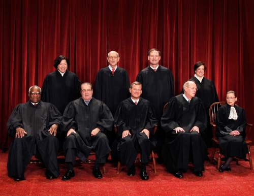 FILE - In this Oct. 8, 2010 file photo, the Supreme Court justices pose for a group photo at the Supreme Court in Washington. Seated, from left are, Justice Clarence Thomas, Antonin Scalia, Chief Justice John Roberts, Justice Anthony Kennedy, and Justice Ruth Bader Ginsburg. Standing, from left are, Justices Sonia Sotomayor, Stephen Breyer, Samuel Alito Jr., and Elena Kagan. On Saturday, Feb. 13, 2016, the U.S. Marshals Service confirmed that Scalia has died at the age of 79. (AP Photo/Pablo Martinez Monsivais, File)
