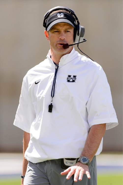 Trent Nelson  |  The Salt Lake Tribune Coach Matt Wells at the Utah State spring football game in Maverik Stadium, Logan, Saturday April 11, 2015.