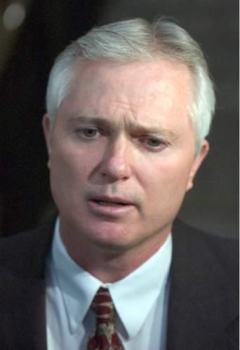 Rick Egan     The Salt Lake Tribune   Polygamist John Daniel Kingston talks to the press after the hearing with Judge Valdez Friday October 22, 2004.