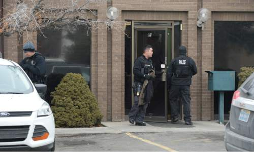Francisco Kjolseth | The Salt Lake Tribune IRS agents raid the property of several Kingston Clan properties, including the offices at 2950 S. Main Street in Salt Lake City on Wednesday, Feb. 10, 2016.
