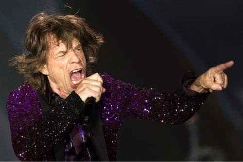 FILE - In this June 4, 2014 file photo, Rolling Stones singer Mick Jagger performs during a concert in Hayrkon Park in Tel Aviv, Israel. (AP Photo/Ariel Schalit, File)