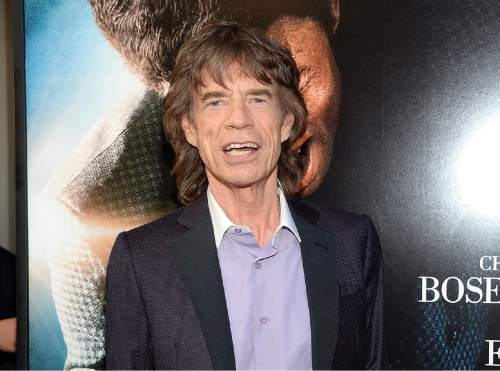"""FILE - In this July 21, 2014 file photo shows musician and producer Mick Jagger at the world premiere of the film """"Get On Up"""" at the Apollo Theater in New York. (Photo by Evan Agostini/Invision/AP, File)"""