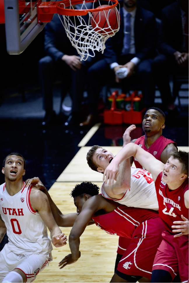 Scott Sommerdorf      The Salt Lake Tribune Utah Utes forward Jakob Poeltl (42) follows the ball as it rolls in while he gets caught up in the battle for rebound positioning underneath the basket. Utah routed Washington State 88-47, Sunday, February 14, 2016.