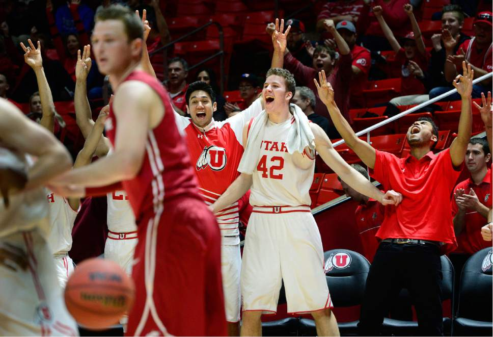 Scott Sommerdorf      The Salt Lake Tribune The Utah bench erupts as backup guard Austin Eastman hits a 3-point shot late in the Utes rout of Washington State. Utah defeated Washington State 88-47, Sunday, February 14, 2016.