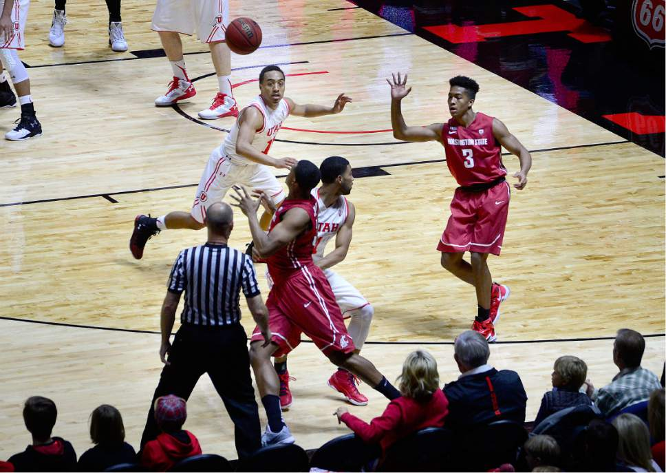 Scott Sommerdorf      The Salt Lake Tribune Utah Utes guard Brandon Taylor (11) follows the path of a Washington State pass as he guards Cougar Ny Redding during first half play. Utah routed Washington State 88-47, Sunday, February 14, 2016.