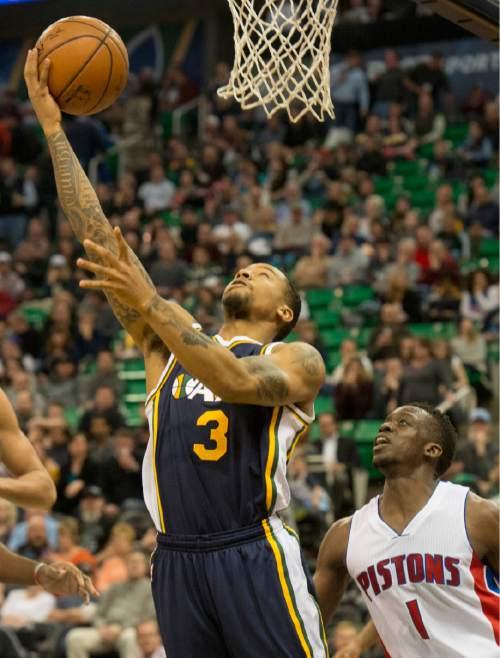Rick Egan     The Salt Lake Tribune  Utah Jazz guard Trey Burke (3) takes the ball to the hoop, as Detroit Pistons guard Reggie Jackson (1) looks on, in NBA action, The Utah Jazz vs. The Detroit Pistons, in Salt Lake City, Monday, January 25, 2016.