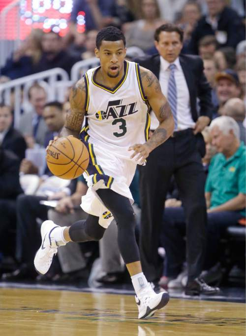 FILE - This Thursday, Oct. 22, 2015, file photo, shows Utah Jazz guard Trey Burke (3) bringing the ball up court in the second half during NBA preseason basketball game, in Salt Lake City. The loss of Dante Exum to injury sent ripples throughout the Jazz lineup that will be felt on both sides of the ball. The opportunities for Trey Burke and Raul Neto have grown exponentially especially after Bryce Cotton was released last week. (AP Photo/Rick Bowmer, File)
