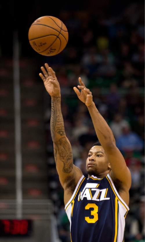 Lennie Mahler  |  The Salt Lake Tribune  Trey Burke drains one of his four 3-point shots of the game in the first half as the Utah Jazz faced the Brooklyn Nets at EnergySolutions Arena in Salt Lake City, Saturday, Jan. 24, 2015.