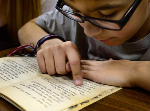 Scott Sommerdorf   |  The Salt Lake Tribune Fourth Grade student Enrique Roman is one of the young students being helped by U of U student tutors at the University of Utah Reading Clinic, Thursday, February 4, 2016.