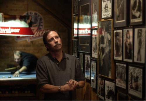 Trent Nelson  |  The Salt Lake Tribune   John Paul Brophy, one of the owners of Salt Lake City's Dead Goat Saloon, inside the bar standing near autographed celebrity portraits on Thursday September 16, 2003.