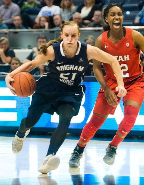 Rick Egan  |  The Salt Lake Tribune  Brigham Young Cougars guard Lexi Eaton Rydalch (21) takes the ball inside, as Utah Utes forward Tanaeya Boclair (32) calls for help, in basketball action, BYU vs. The Univeristy of Utah,  in the Marriott Center, Saturday, December 12, 2015.