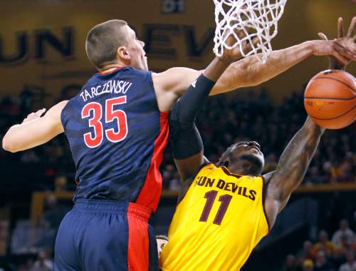 Arizona's Kaleb Tarczewski (35) blocks the shot of Arizona State's Savon Goodman during the first half of an NCAA college basketball game, Sunday, Jan. 3, 2016, in Tempe, Ariz. (AP Photo/Ralph Freso)