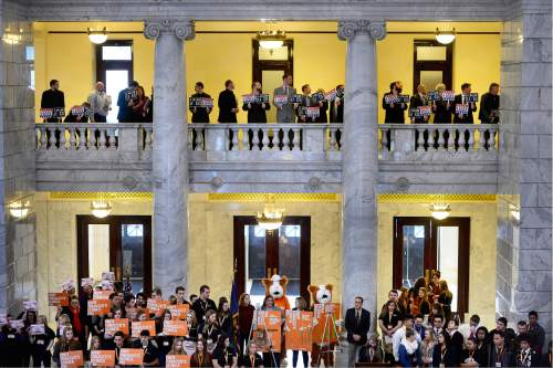 "Scott Sommerdorf   |  The Salt Lake Tribune Pro e-cigarette supporters holds signs above the large ""OUTRAGE!"" group who were there to push for a bill that would change the allowed age to buy tobacco products from 19 to 21 during a rally in the Capitol rotunda, Wednesday, February 17, 2016."
