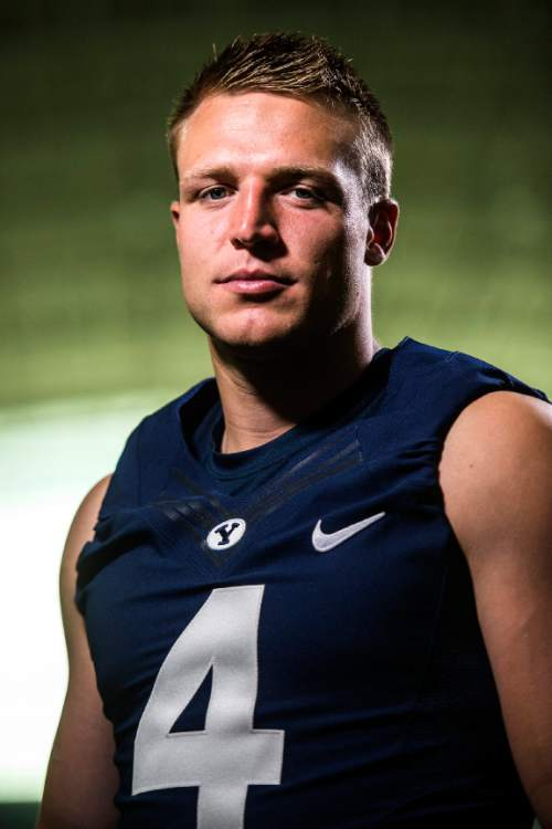 Chris Detrick  |  The Salt Lake Tribune Brigham Young Cougars quarterback Taysom Hill (4) poses for a portrait Wednesday August 12, 2015.